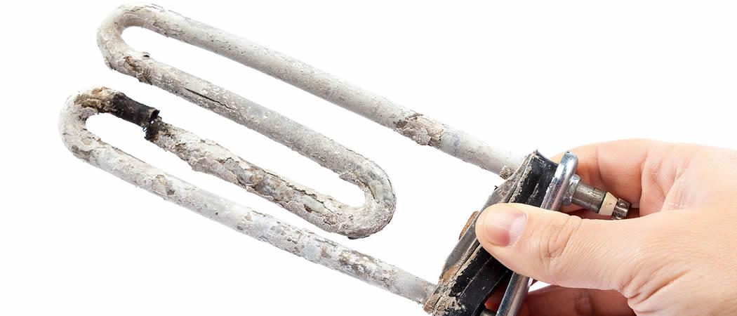 Kalkaanslag Verwijderen - verkalkte wasmachine